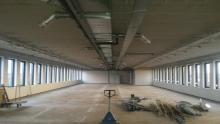 Eerste fase (strippen) voor de realisatie van appartementen in leegstaand kantoorgebouw